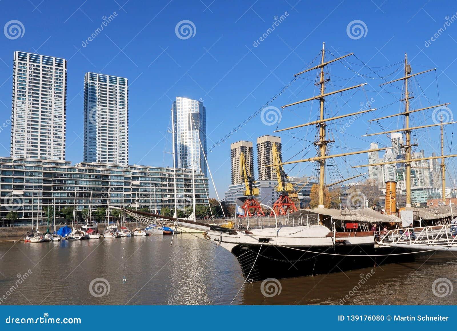 Historic sailing ship on Rio de la Plata river in the modern district Puerto Madero, Buenos Aires, Argentina