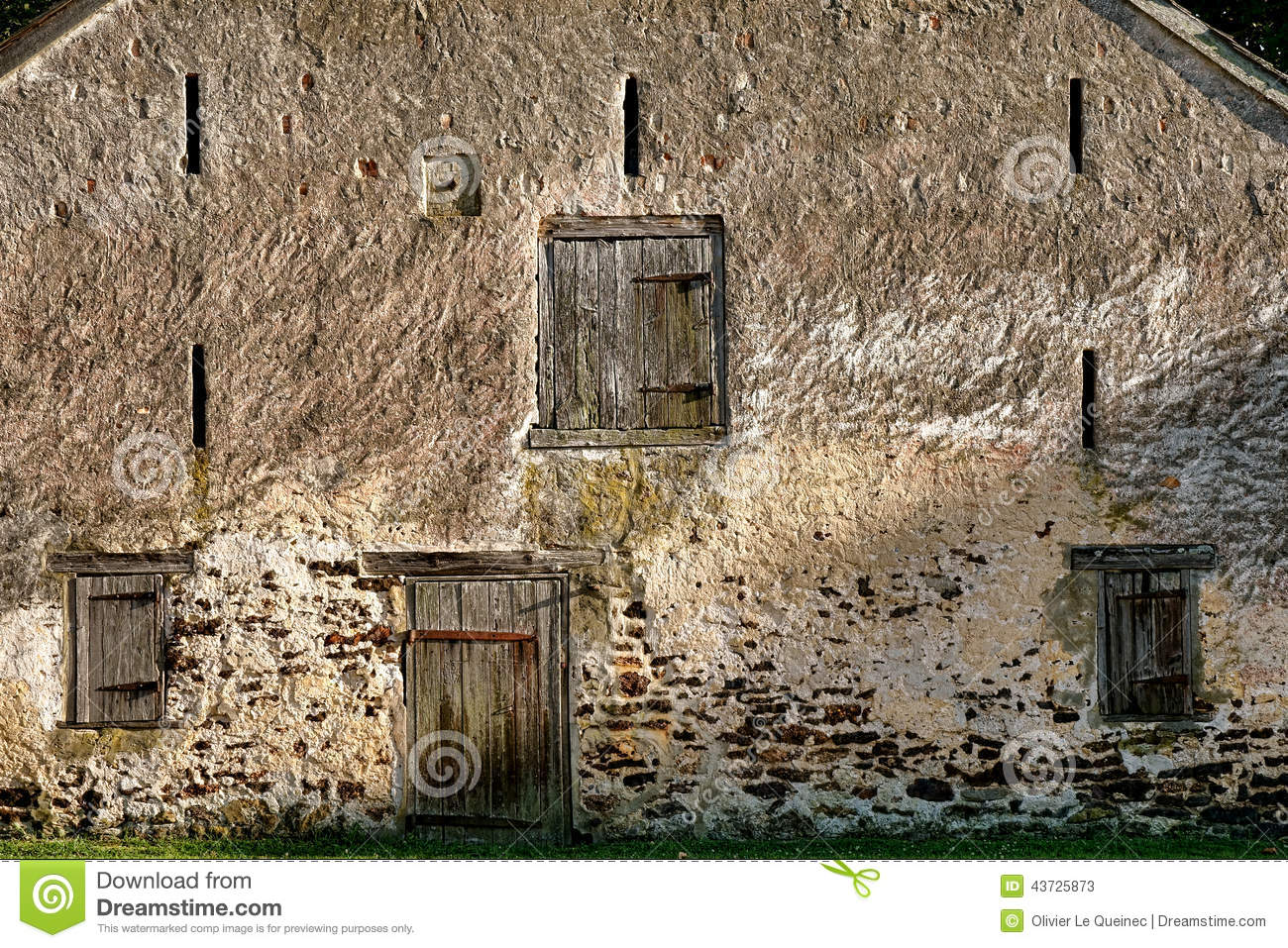 Historic stone masonry barn and antique wood doors stock for Narrow barn door