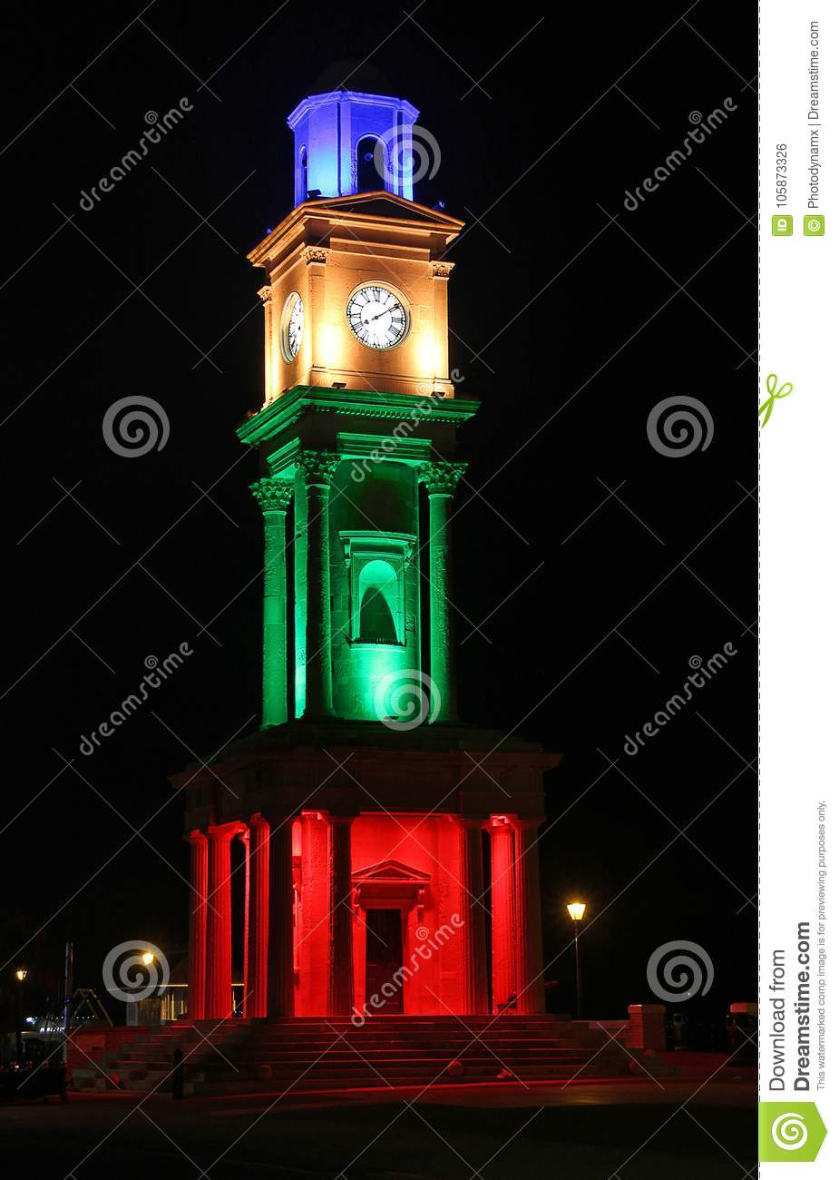 Historic victorian clock tower illuminated