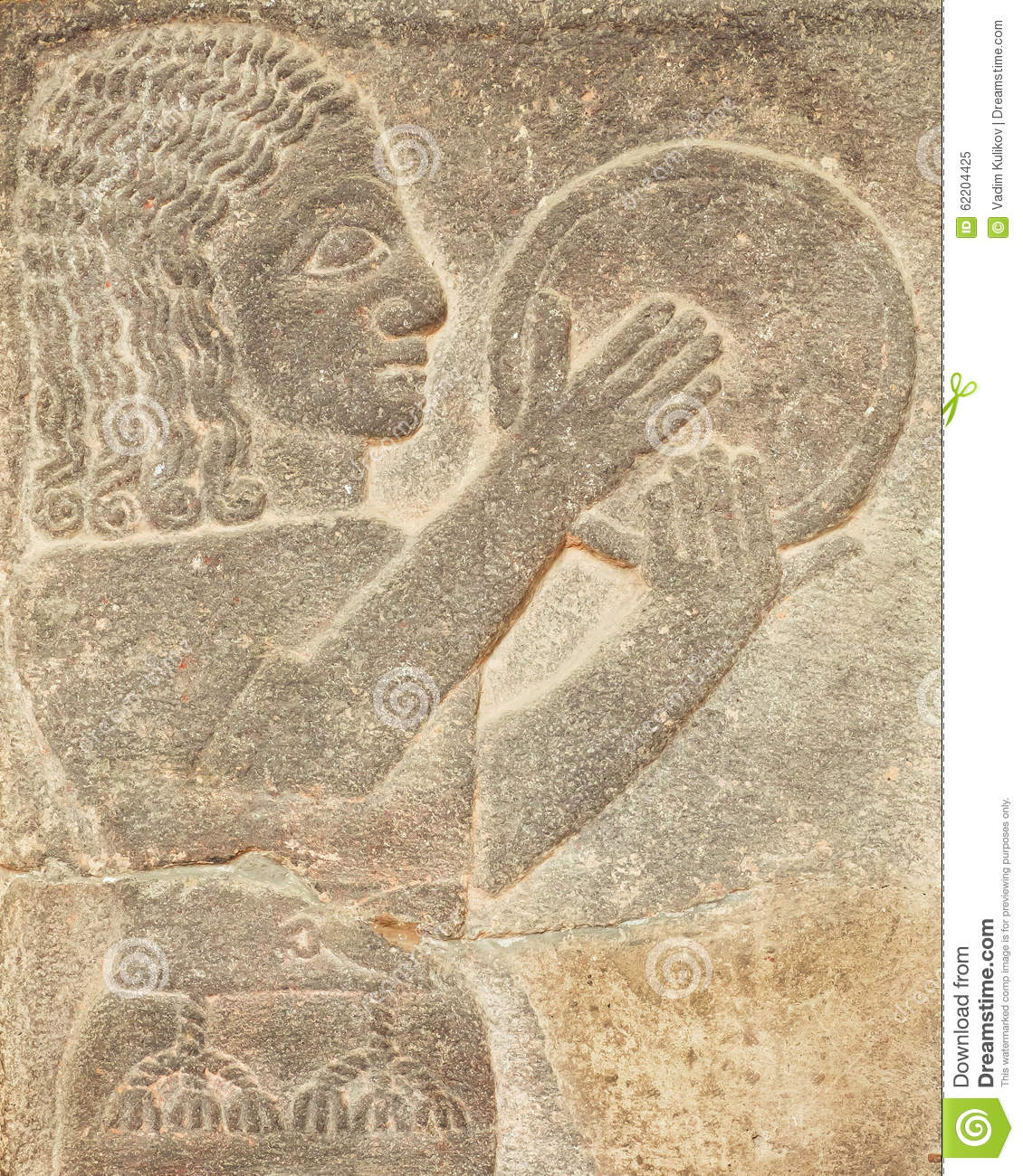 Historical Assyrian Relief Of Musician With Drum Playing Traditional
