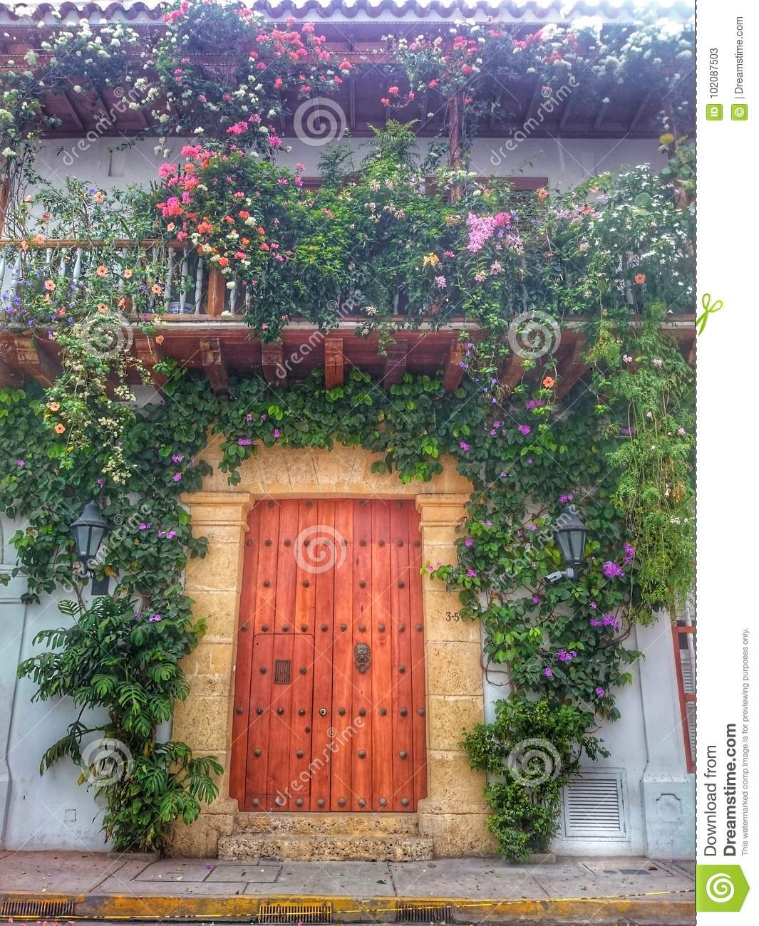 Historical House entrance with flowers and plants
