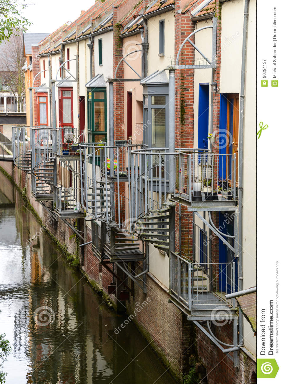 Historical houses with balconies and spiral staircases