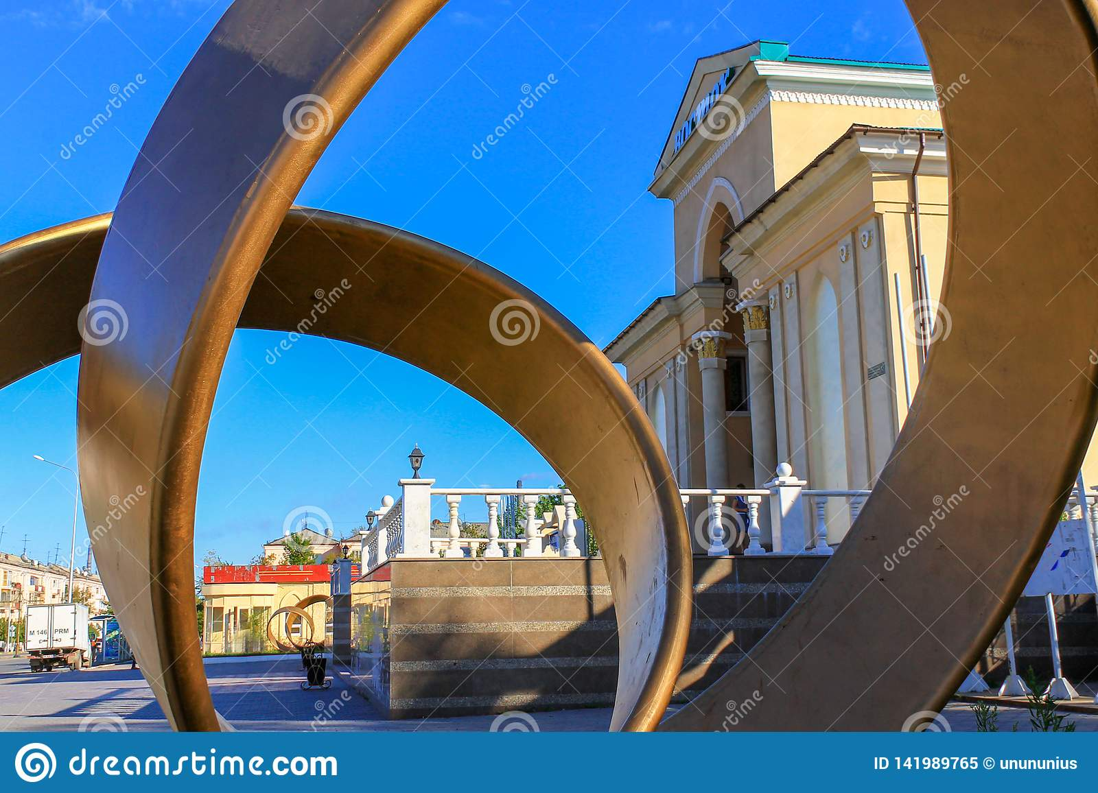 Historical Main Entrance to the large Cinema Theater, called Wostok. Look through the Monument. Near Kio park. Located Downtown of