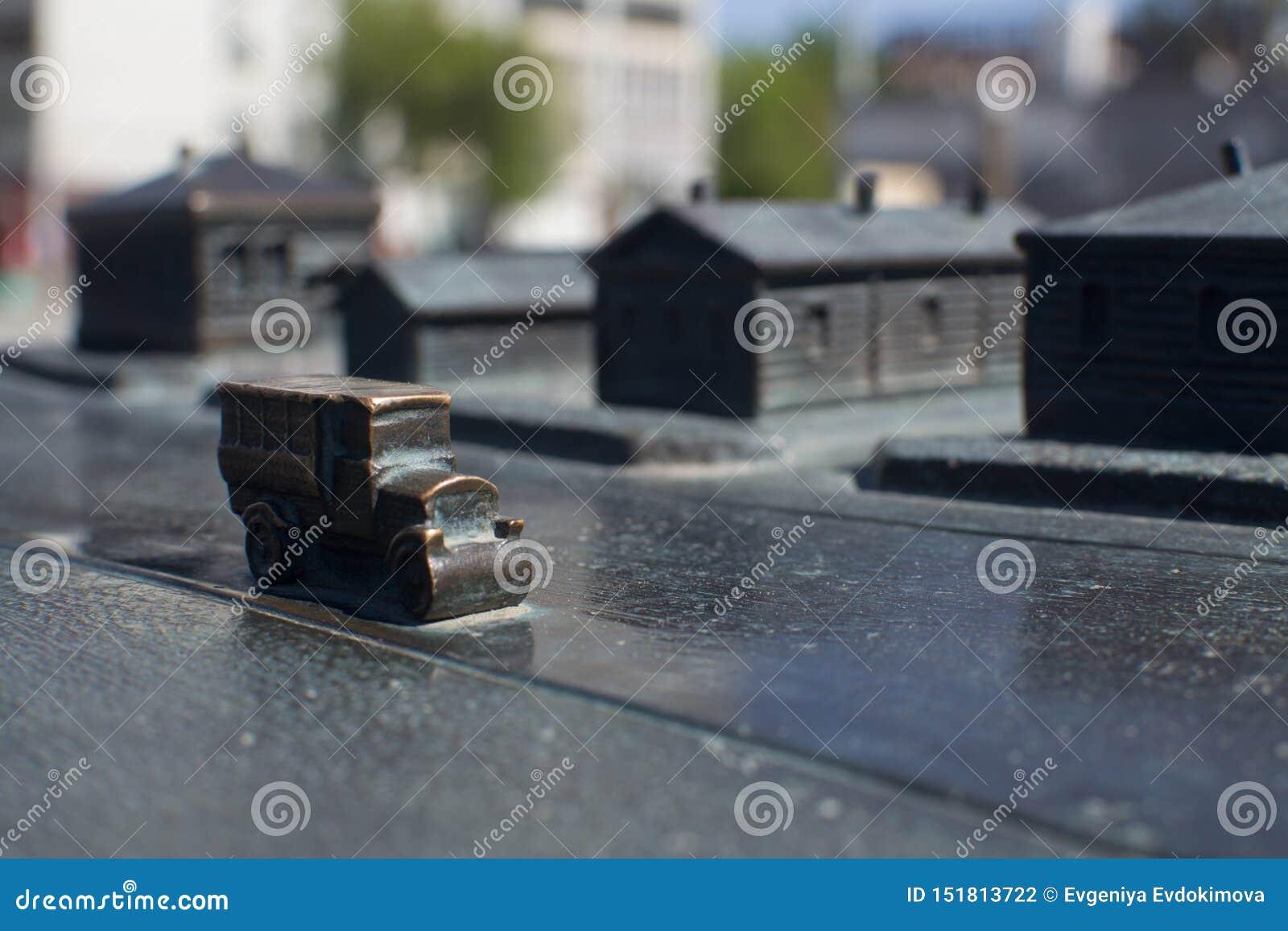 Historical miniature scene cast iron old car