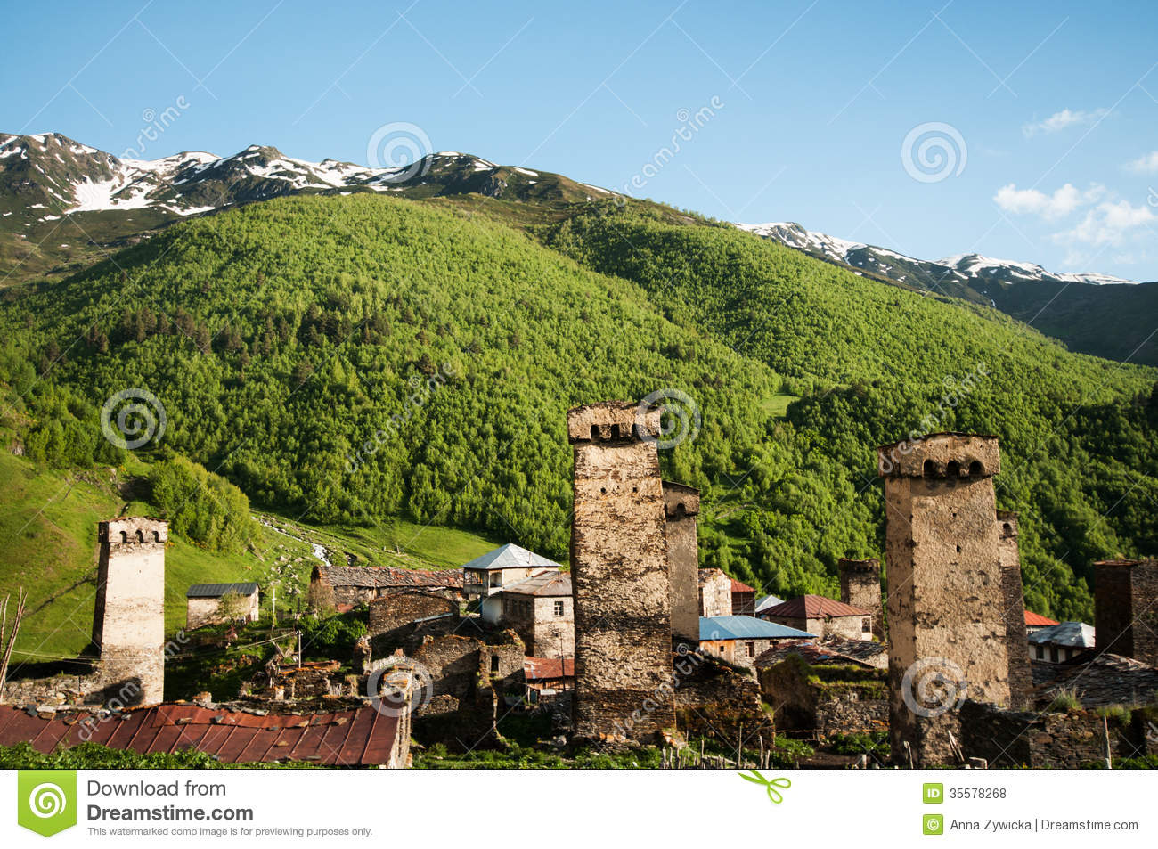 Historical towers and huts in mountain village.