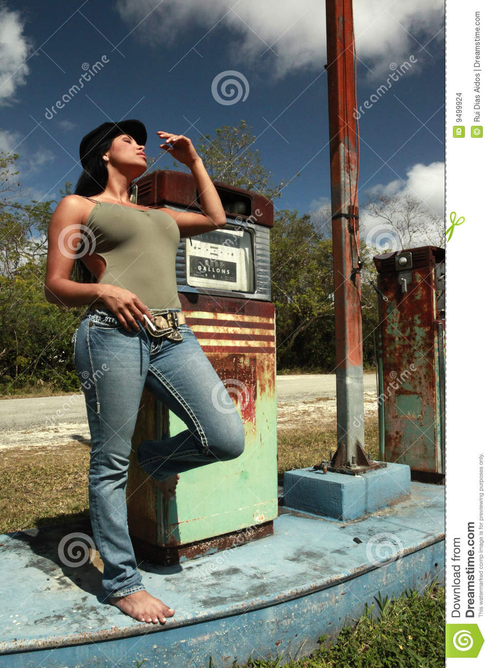 Hitchhiker At A Vintage Gas Station Stock Photo - Image ...