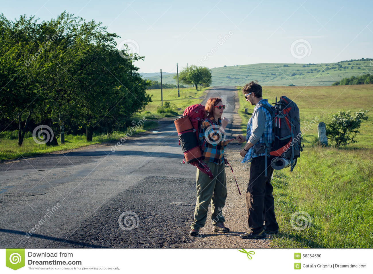 Hitchhikers By Side Of Road >> Hitchhikers Waiting For A Lift Stock Photo Image Of Hitchhiking