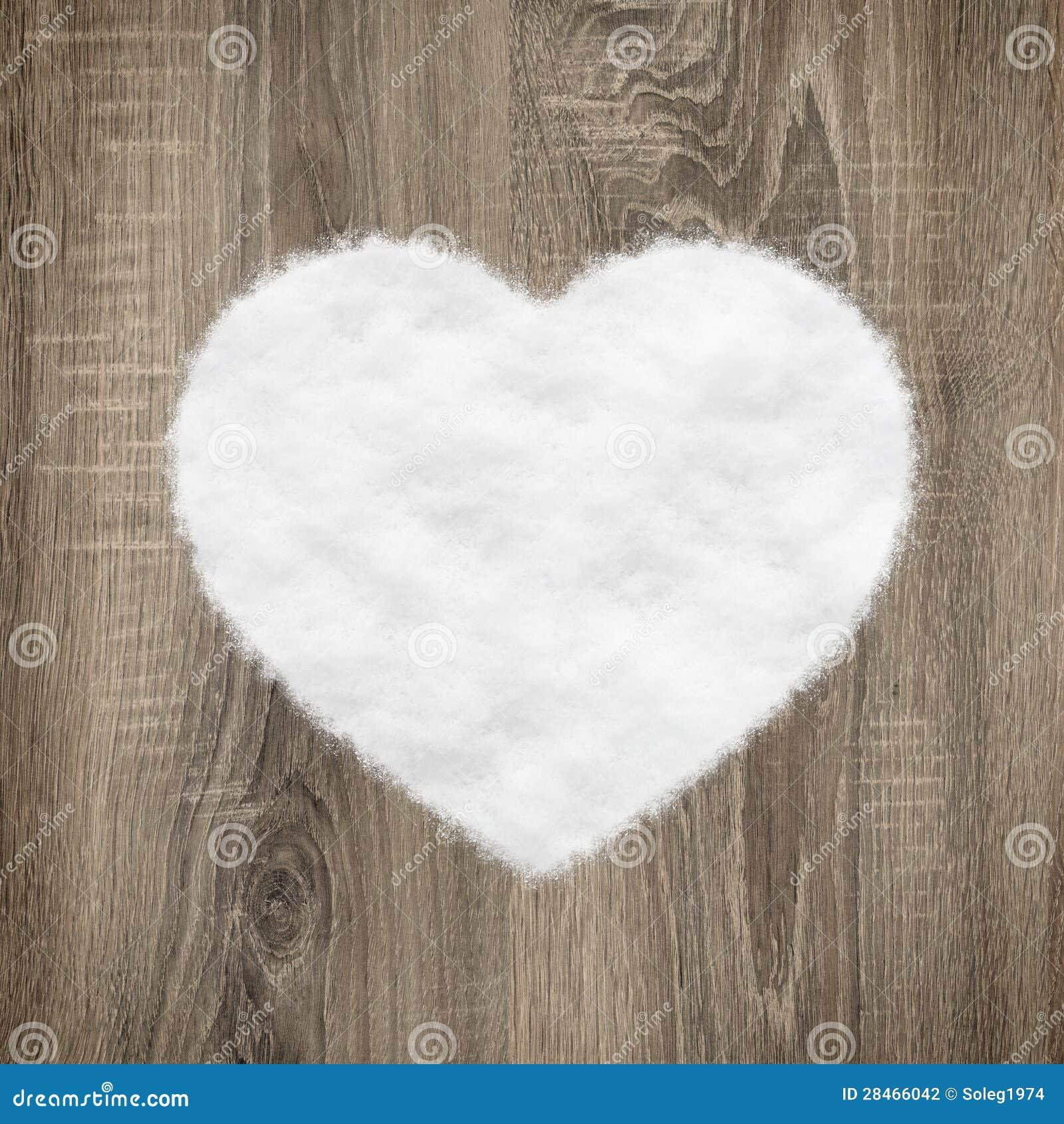 Hjärta formar gjort av trä och snow