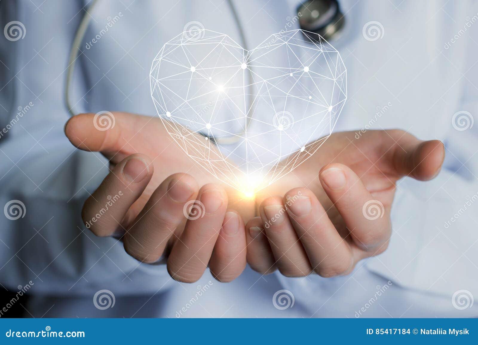 Hjärta i händerna av doktorn