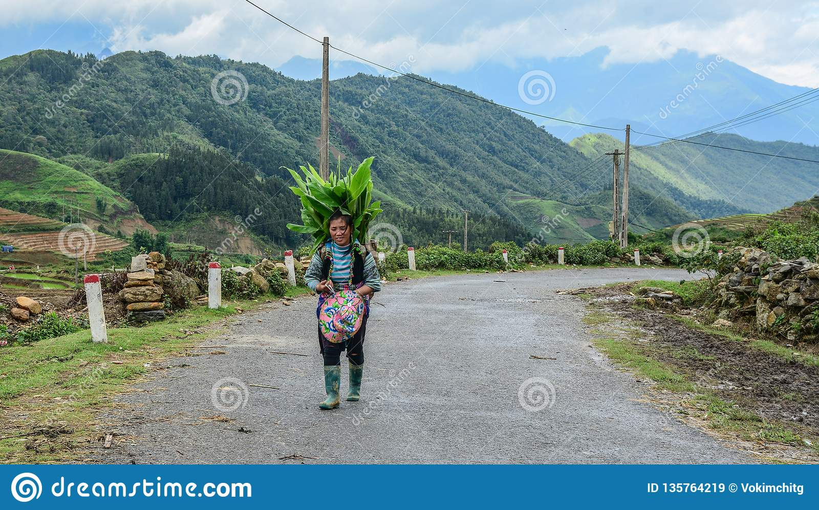 Hmong woman walking on mountain road