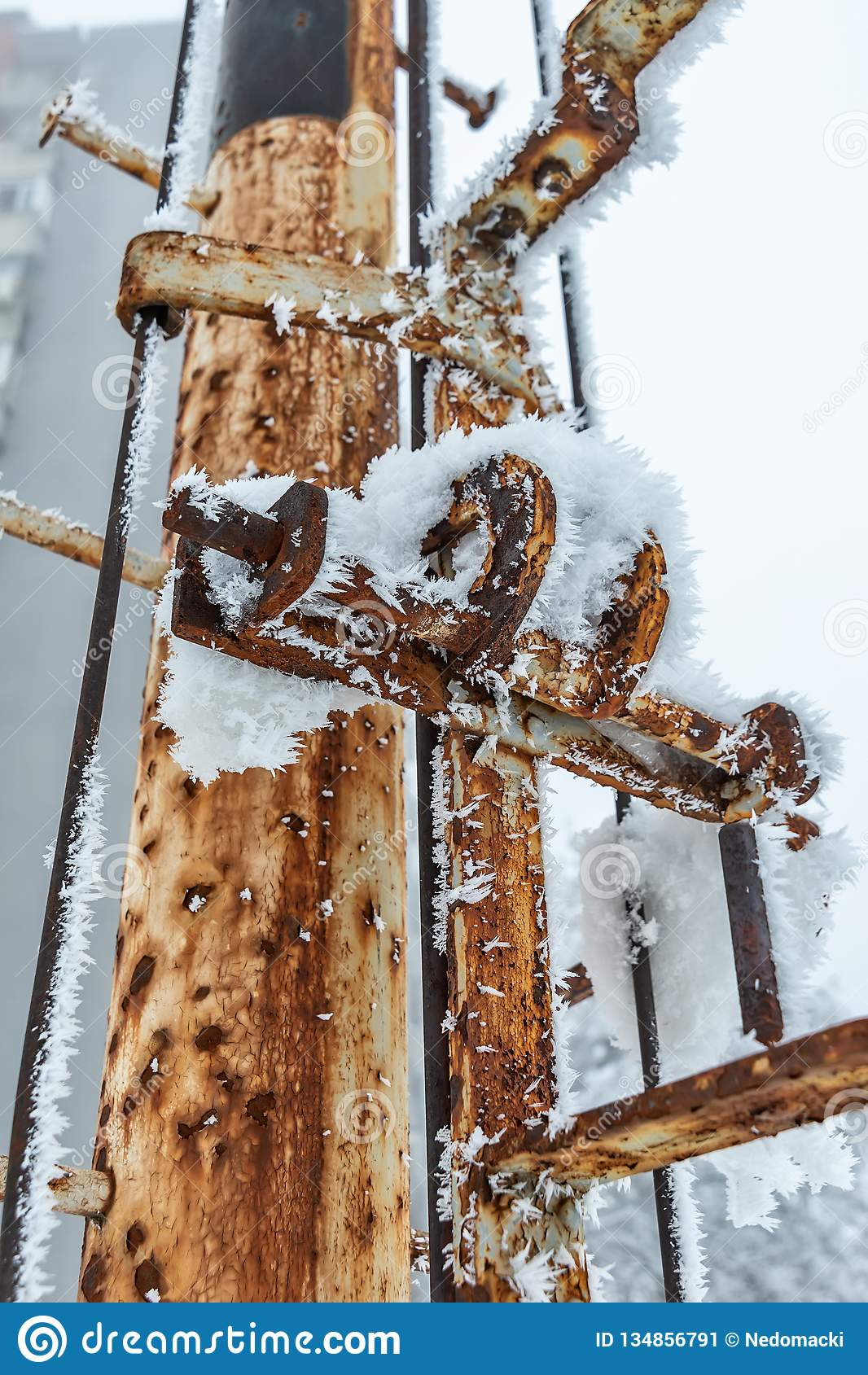 Hoar Frost and snow on metal pole