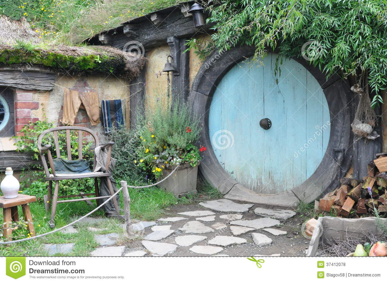 hobbit house with blue door editorial stock photo image. Black Bedroom Furniture Sets. Home Design Ideas