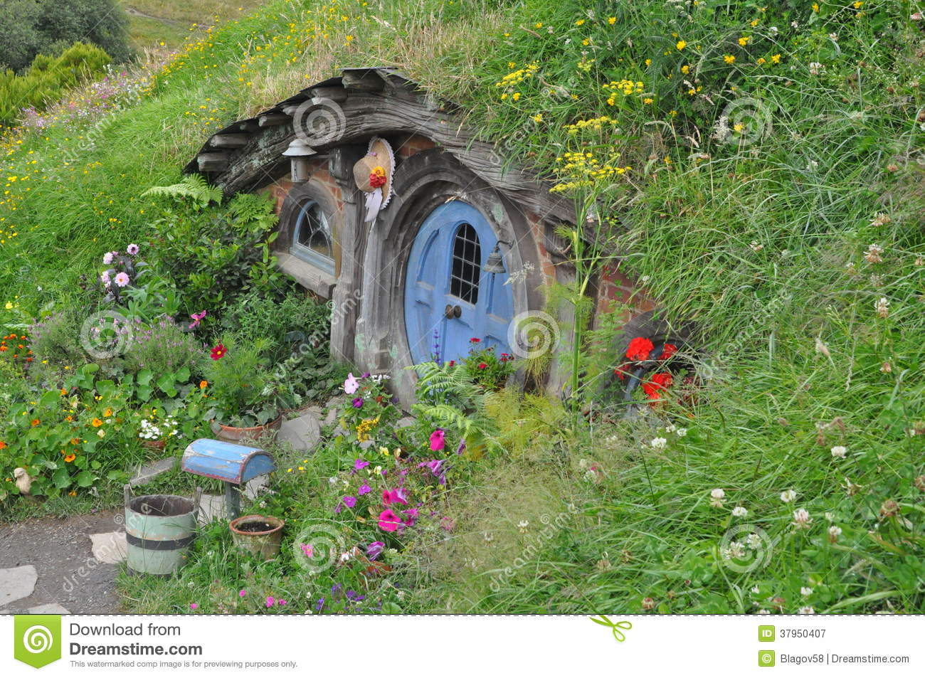 Hobbit house with blue door editorial photography image for Hobbit house images
