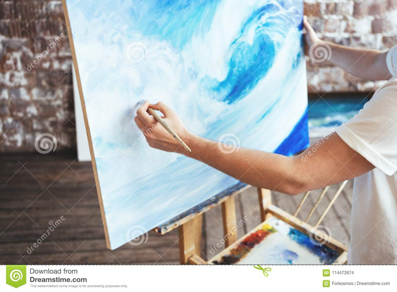 Download Hobby And Creative Occupation Concept. Artist Drawing With Oilpaint And Paintbrush In Studio Stock Photo - Image of leisure, canvas: 114472674