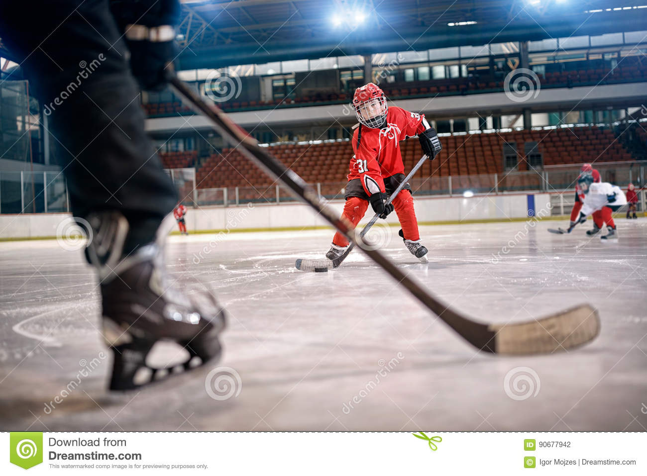 Hockey match at rink player in action