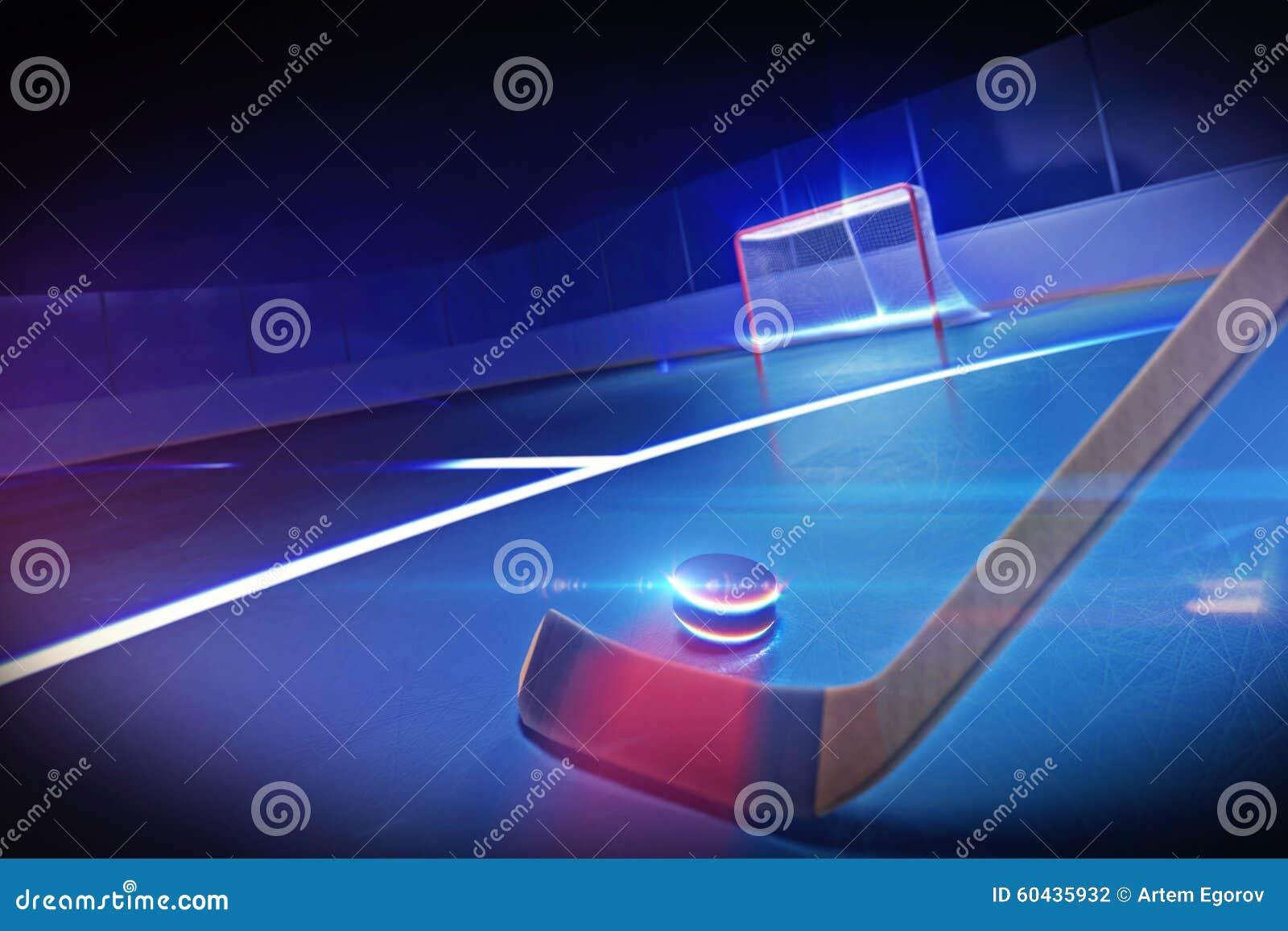 Hockeypinne och puck på isisbanan