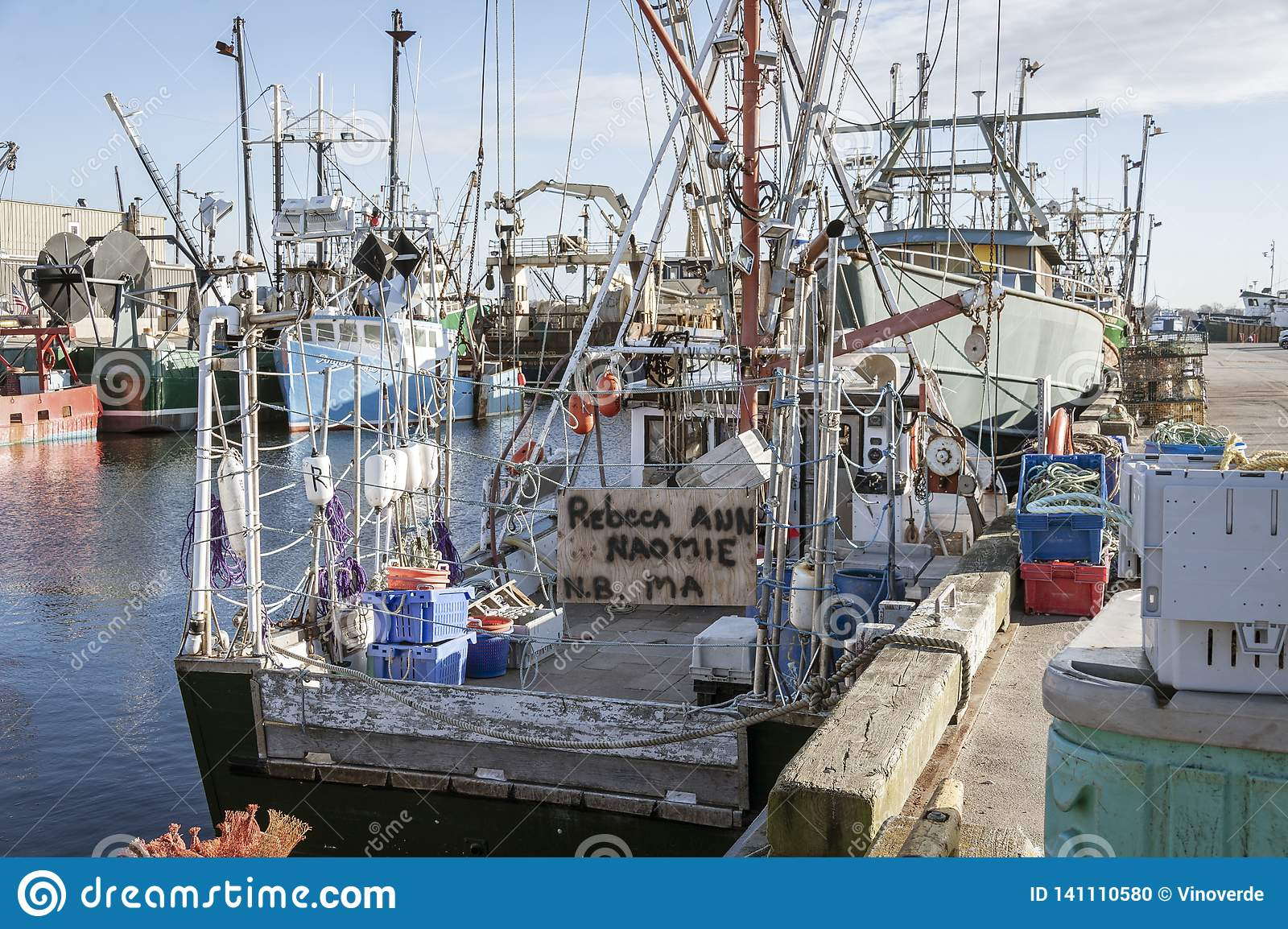 Hodgepodge Of Fishing Boat Rigging On Docked Boats Editorial