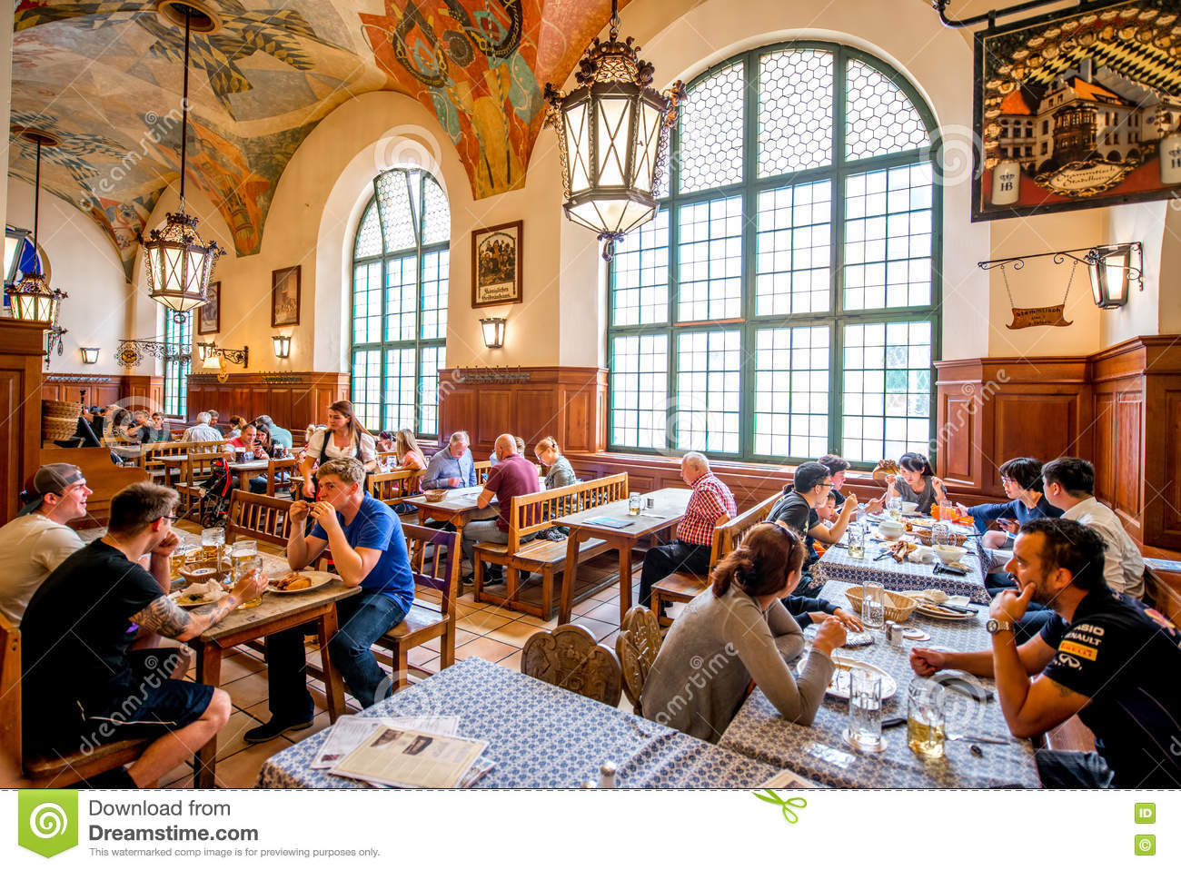 Crowded restaurant table - Hofbrauhaus Interior In Munich Editorial Stock Image