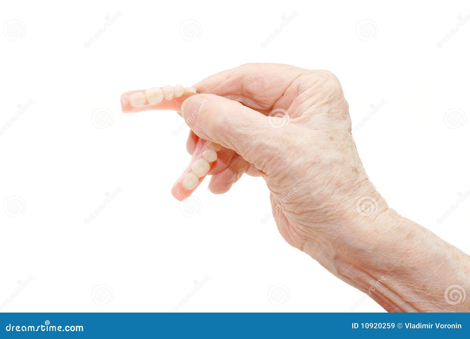 Hogere hand met Tandprothese