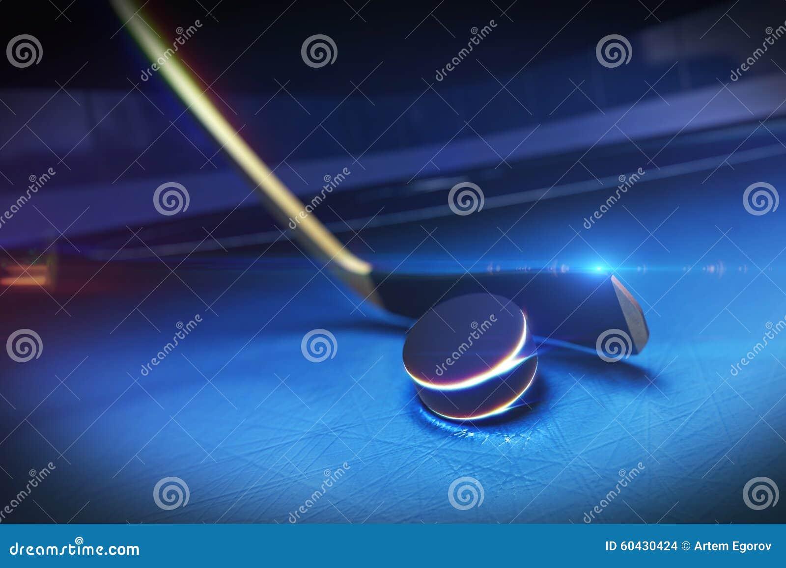 Hokejowy kij i krążek hokojowy na Lodowym lodowisku