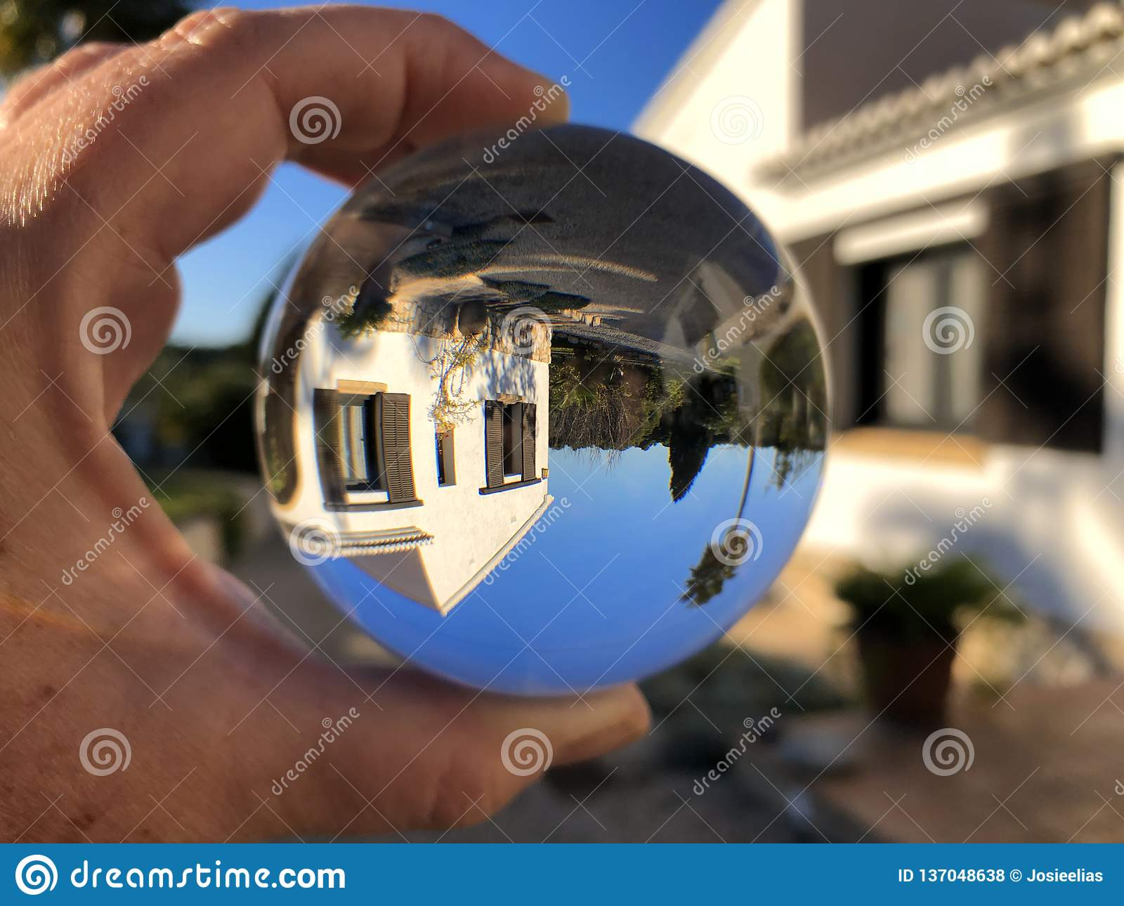 Creative concept, crystal ball and dream home