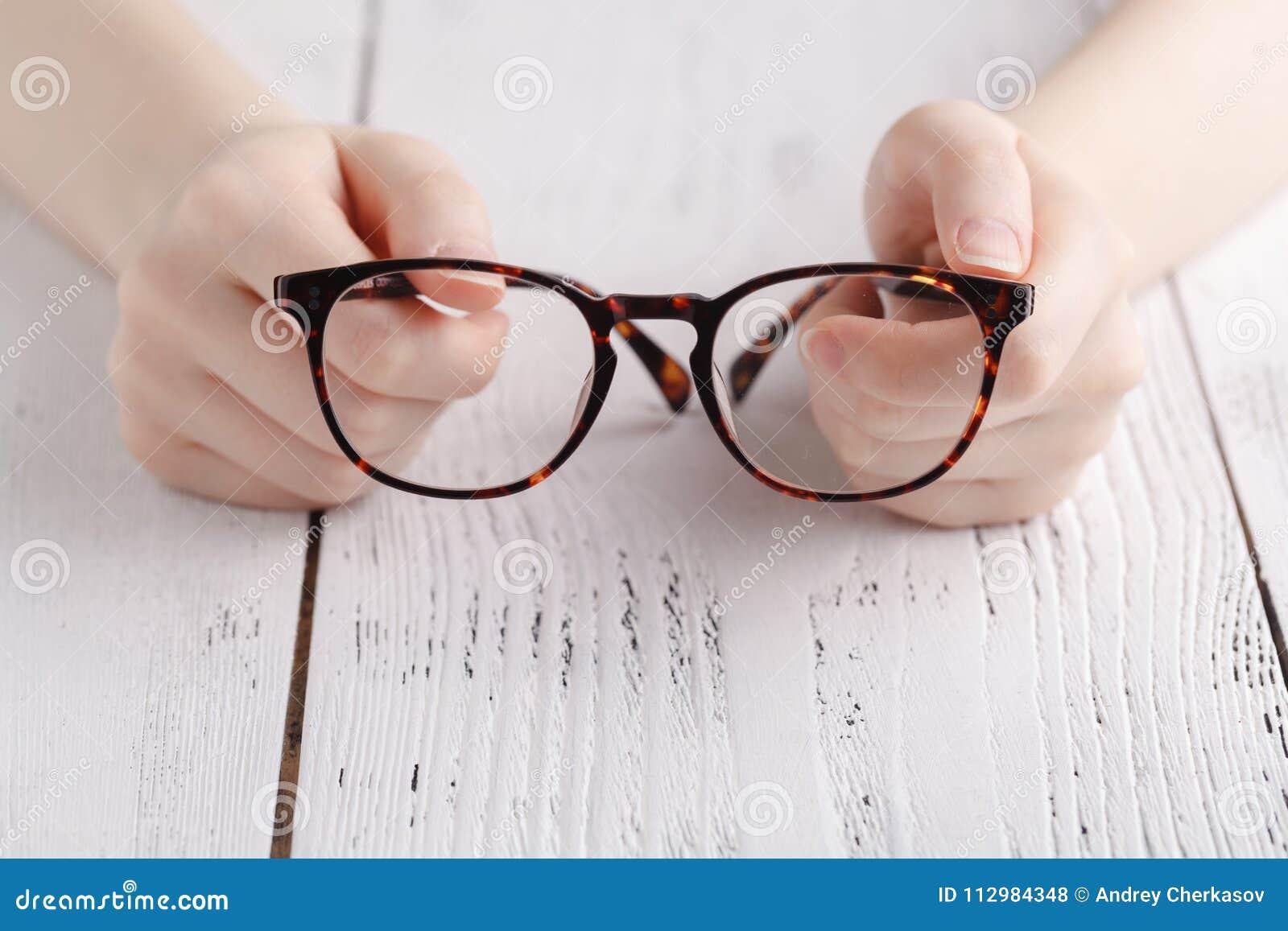 Holding glasses in female hands