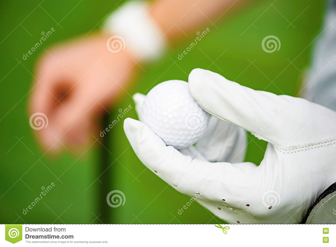 Holding golf ball on hand