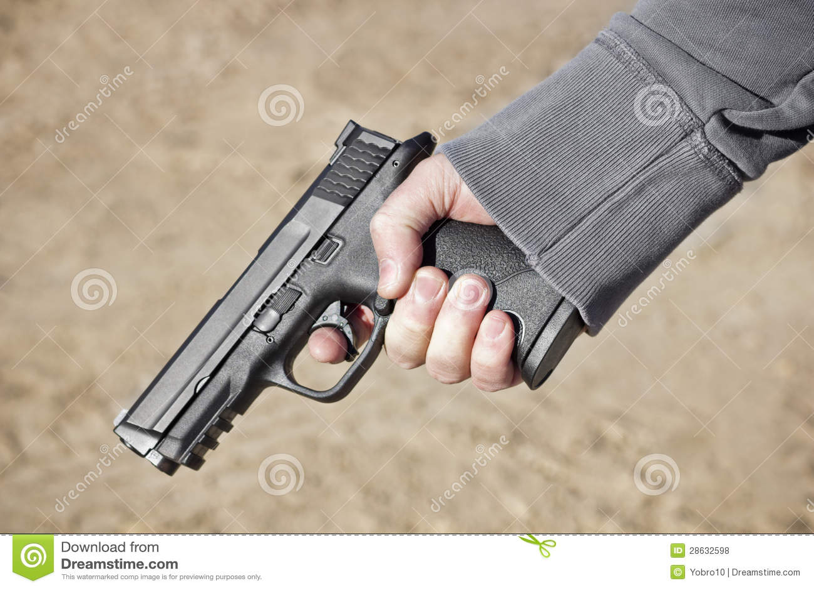 Holding A Hand Gun Royalty Free Stock Photos - Image: 28632598