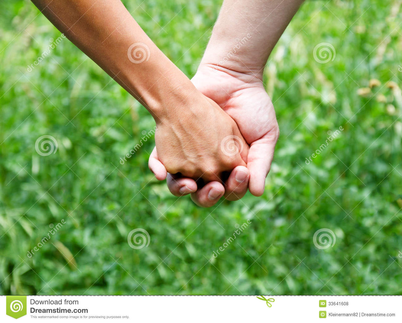 Holding Hands Against A Green Background Royalty Free ...
