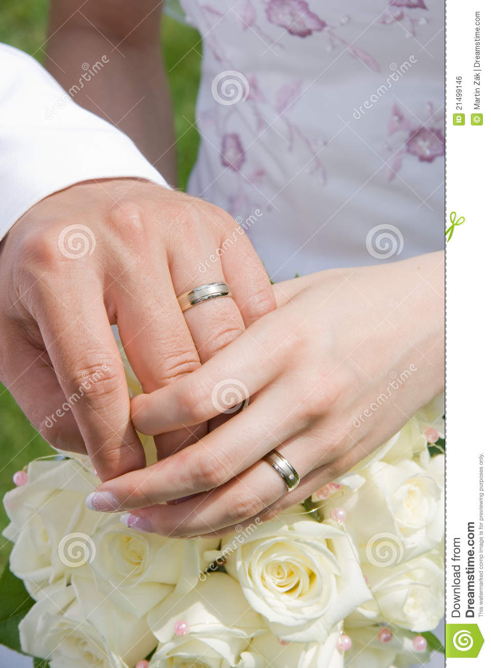 Couple is holding their hands together and showing off their rings    Wedding Rings Holding Hands