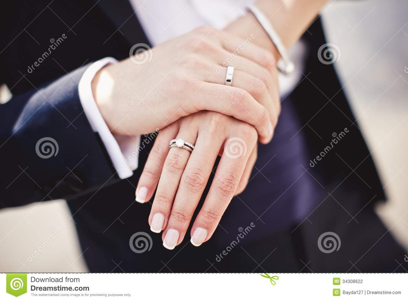 Close up of holding hands with wedding rings Wedding Rings Holding Hands