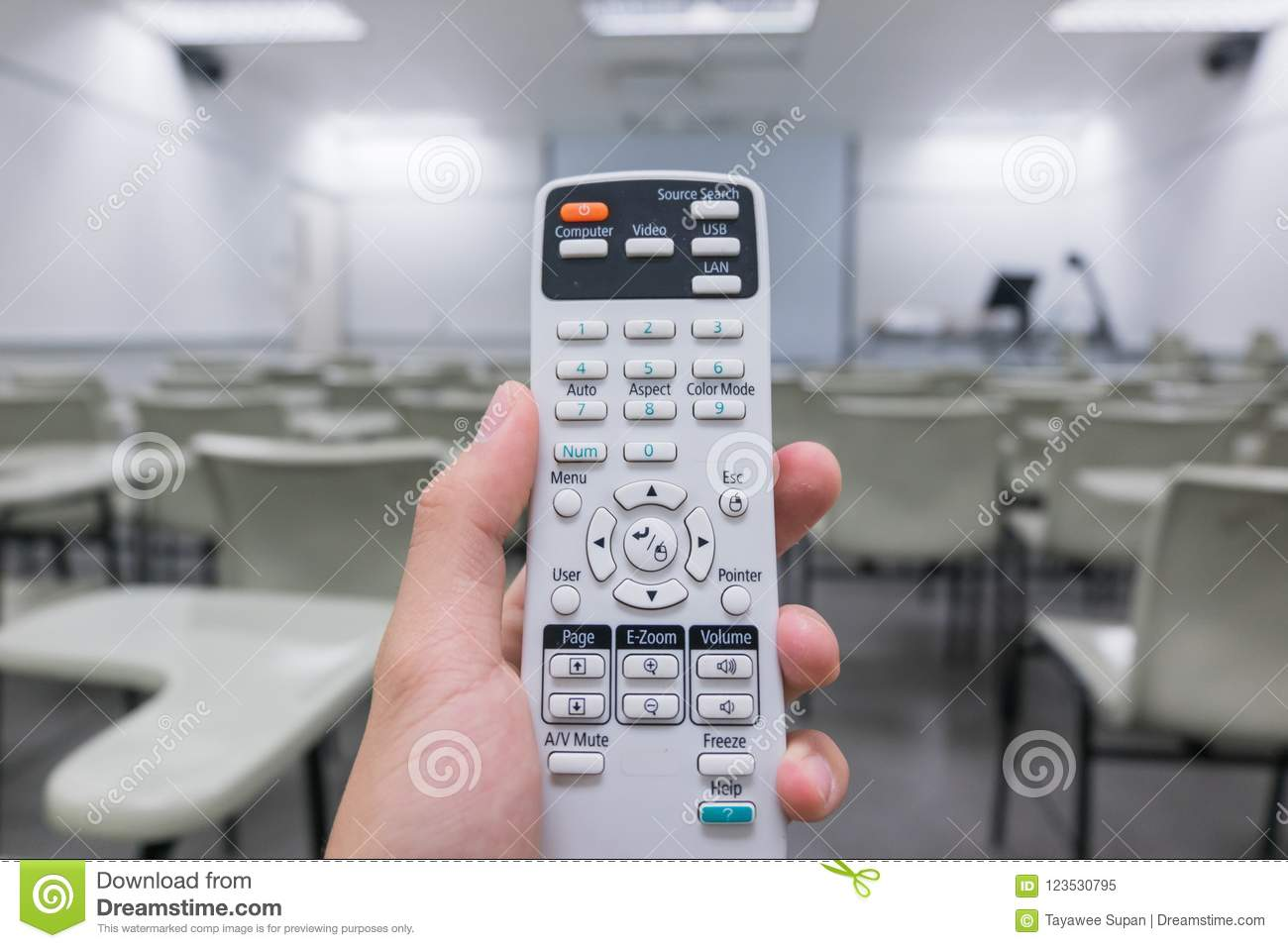 Holding Remote Control Projector In Hand In Classroom Stock Image