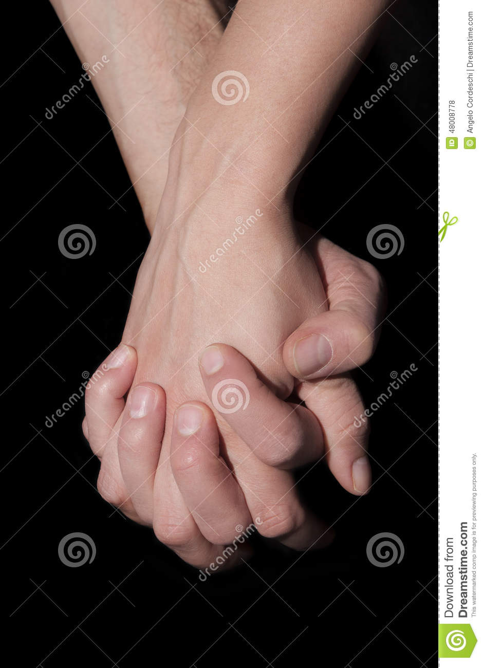 Holding two hands together. Union and love concept.