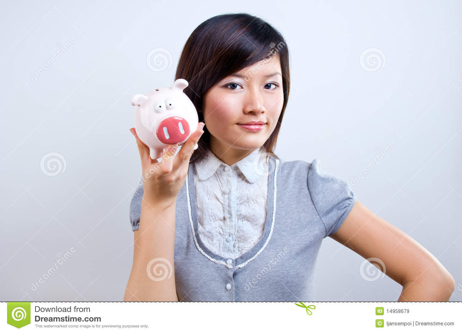 Holdingpiggybankkvinna