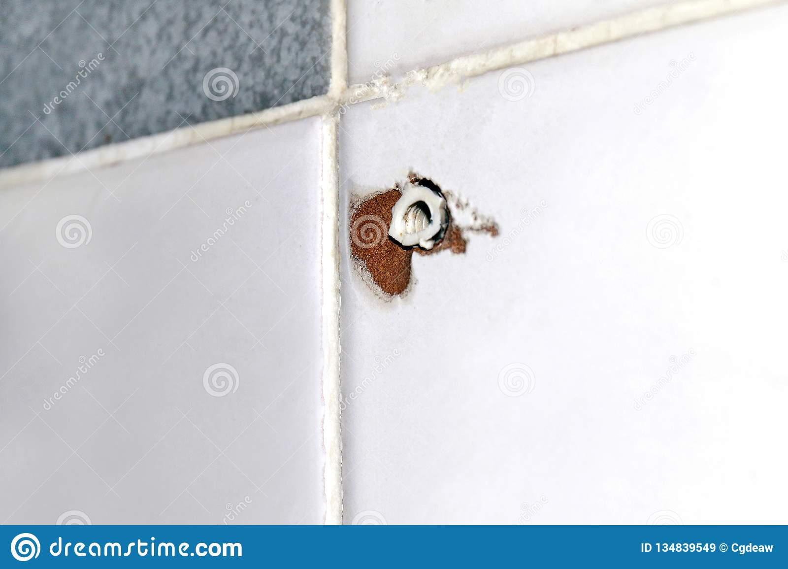 Hole of expansion bolt old at tile wall, old plastic anchors for dowels screws, anchor bolt hole screws on tile, defective