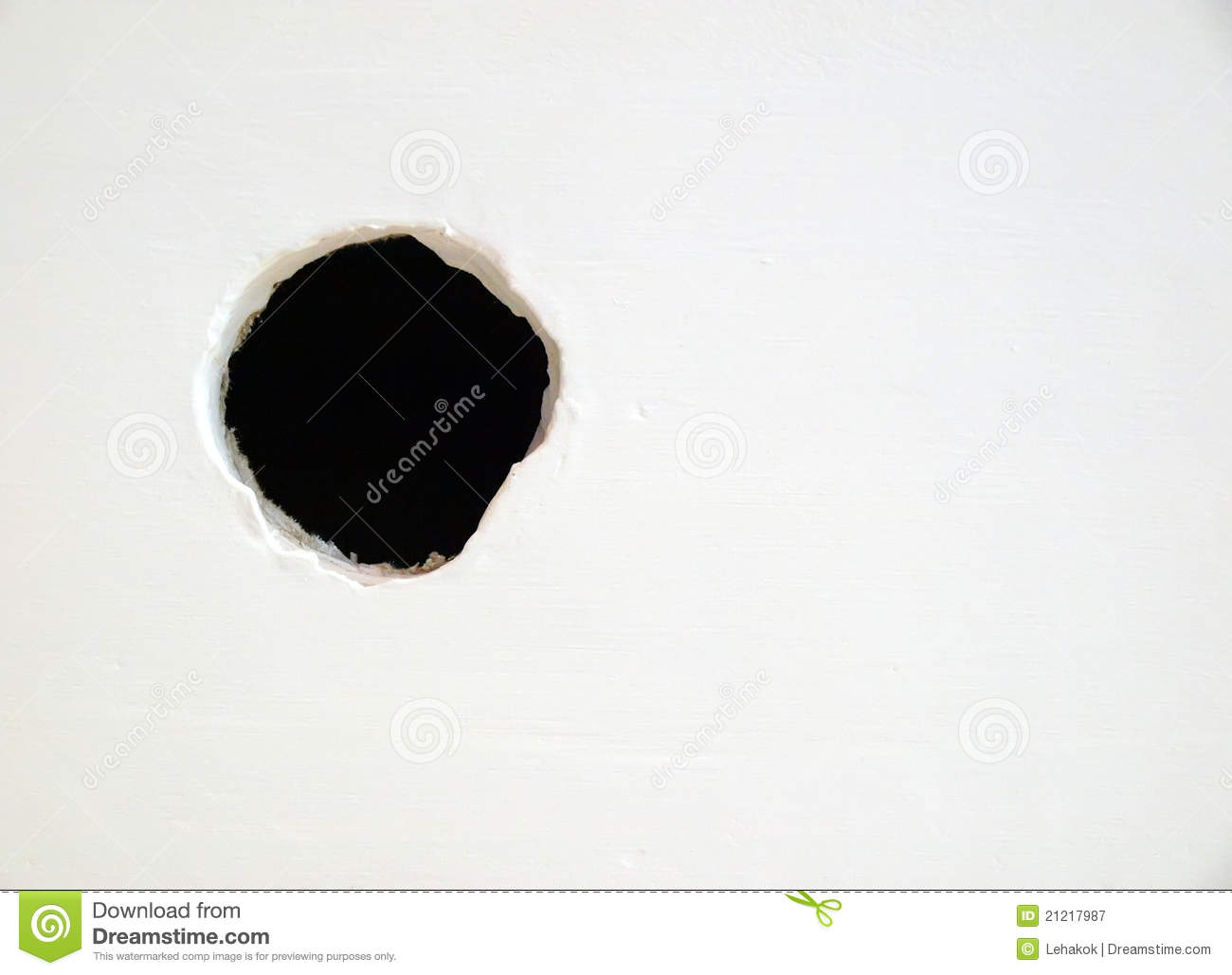 Hole On The White Wall Royalty Free Stock Photography
