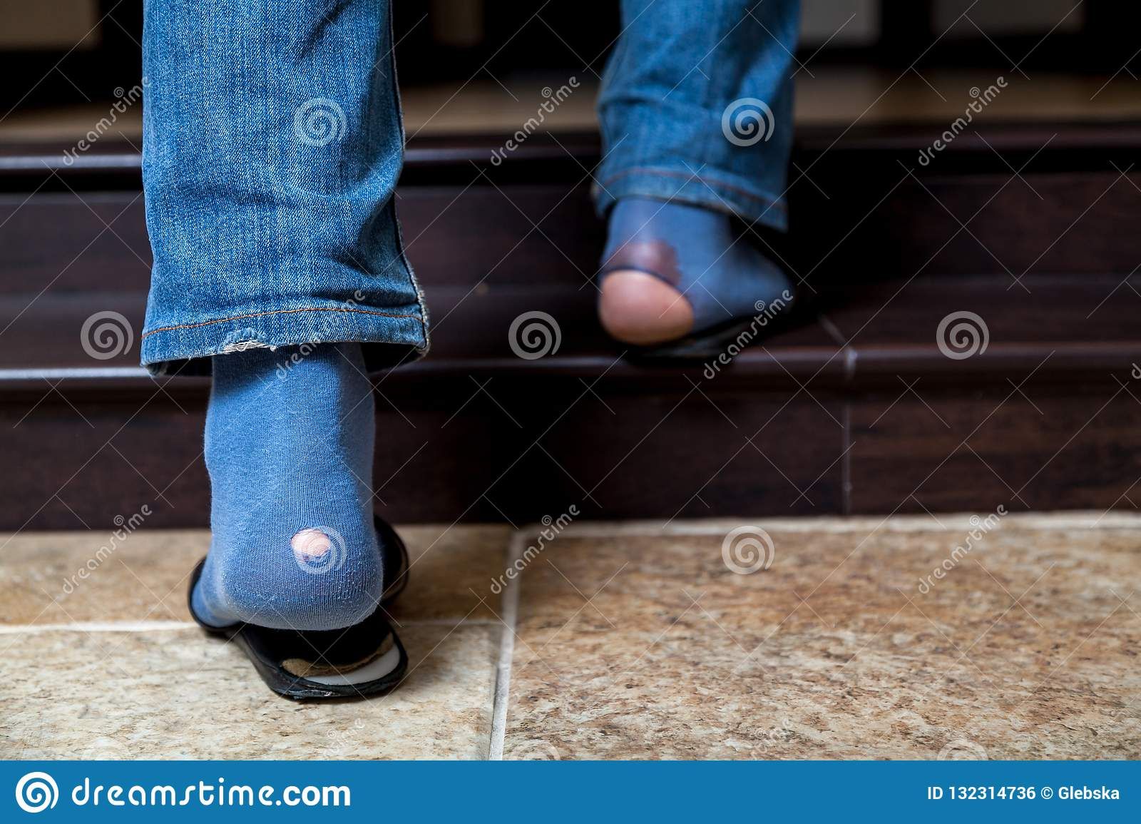 shop for official real deal buy good Feet In Jeans And Holey Socks Go Up Stairs Stock Photo ...
