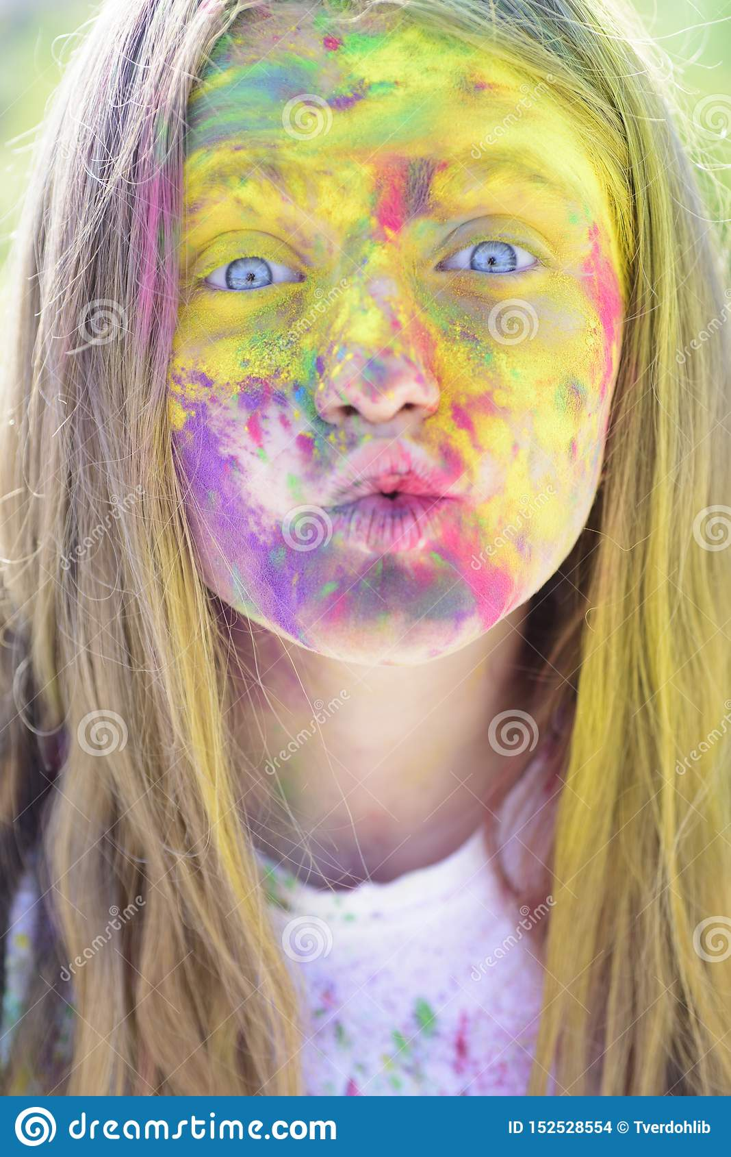 Holi. colorful neon paint makeup. Happy youth party. Optimist. Spring vibes. Crazy hipster girl. Summer weather