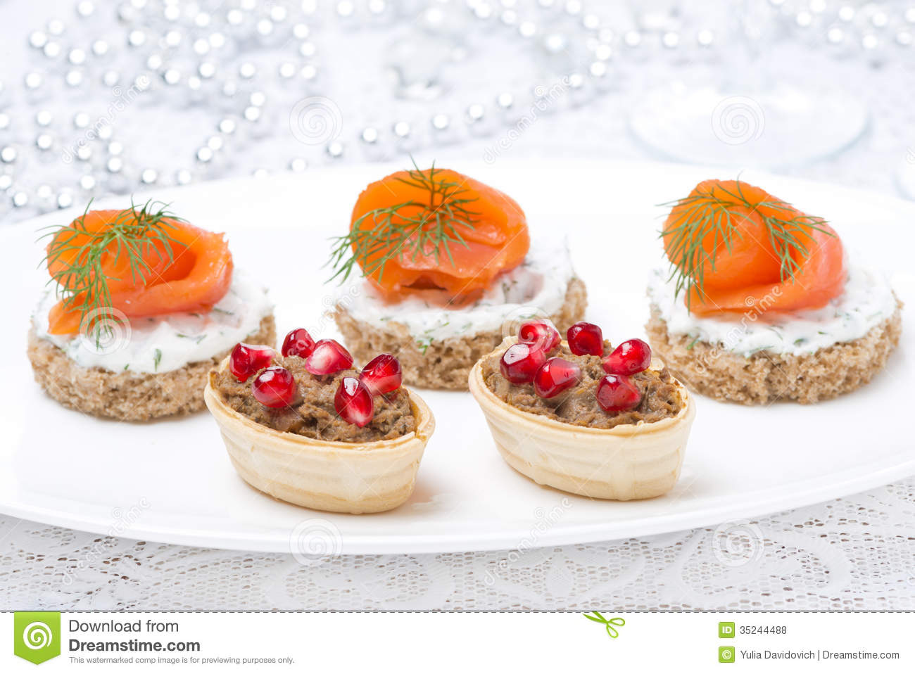 Holiday appetizers - canape with salmon and tartlet with liver pate ...