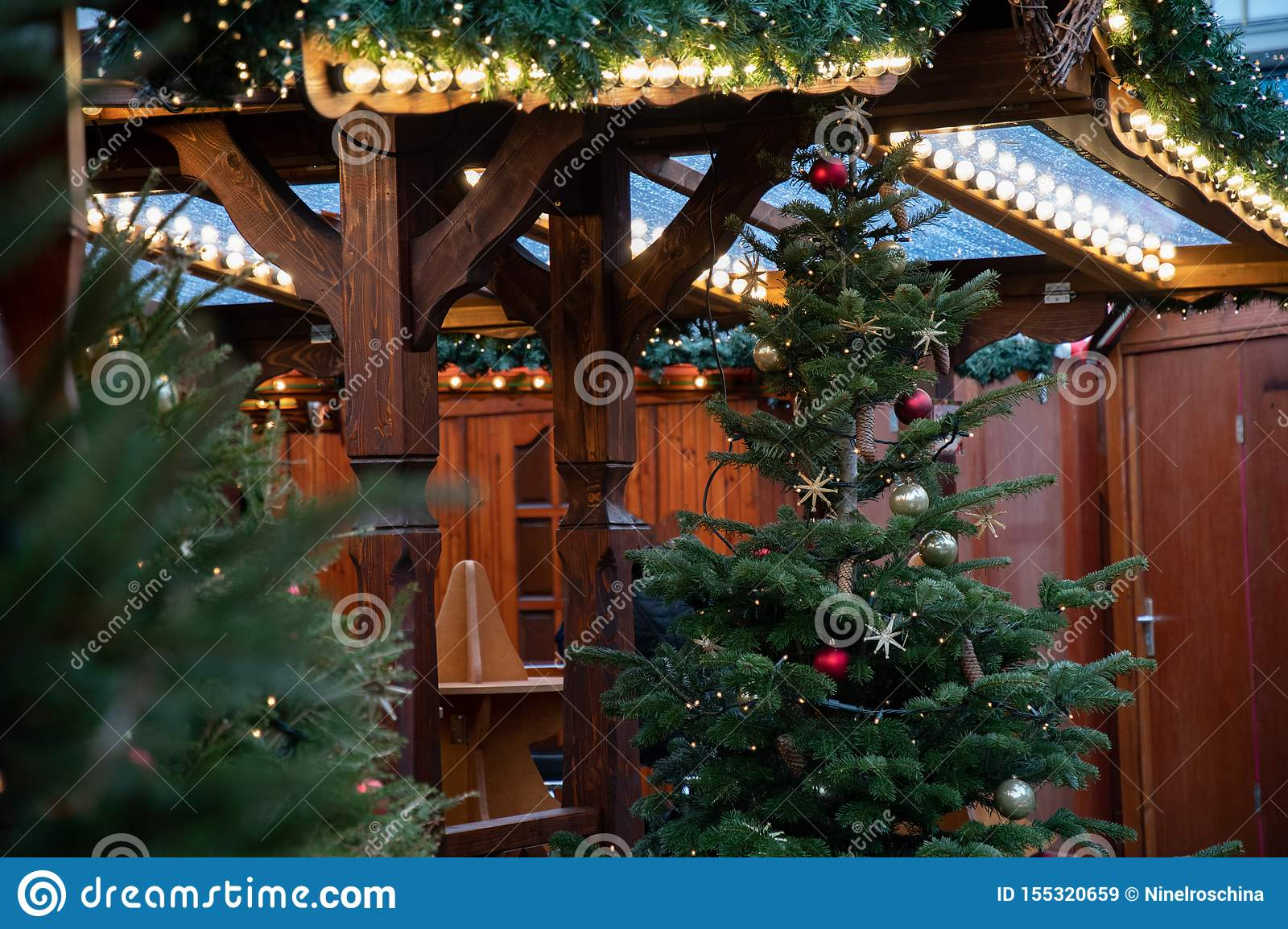 Traditional Christmas Lights.Rows Of Shiny Christmas Lights At Wooden Pavilion Of