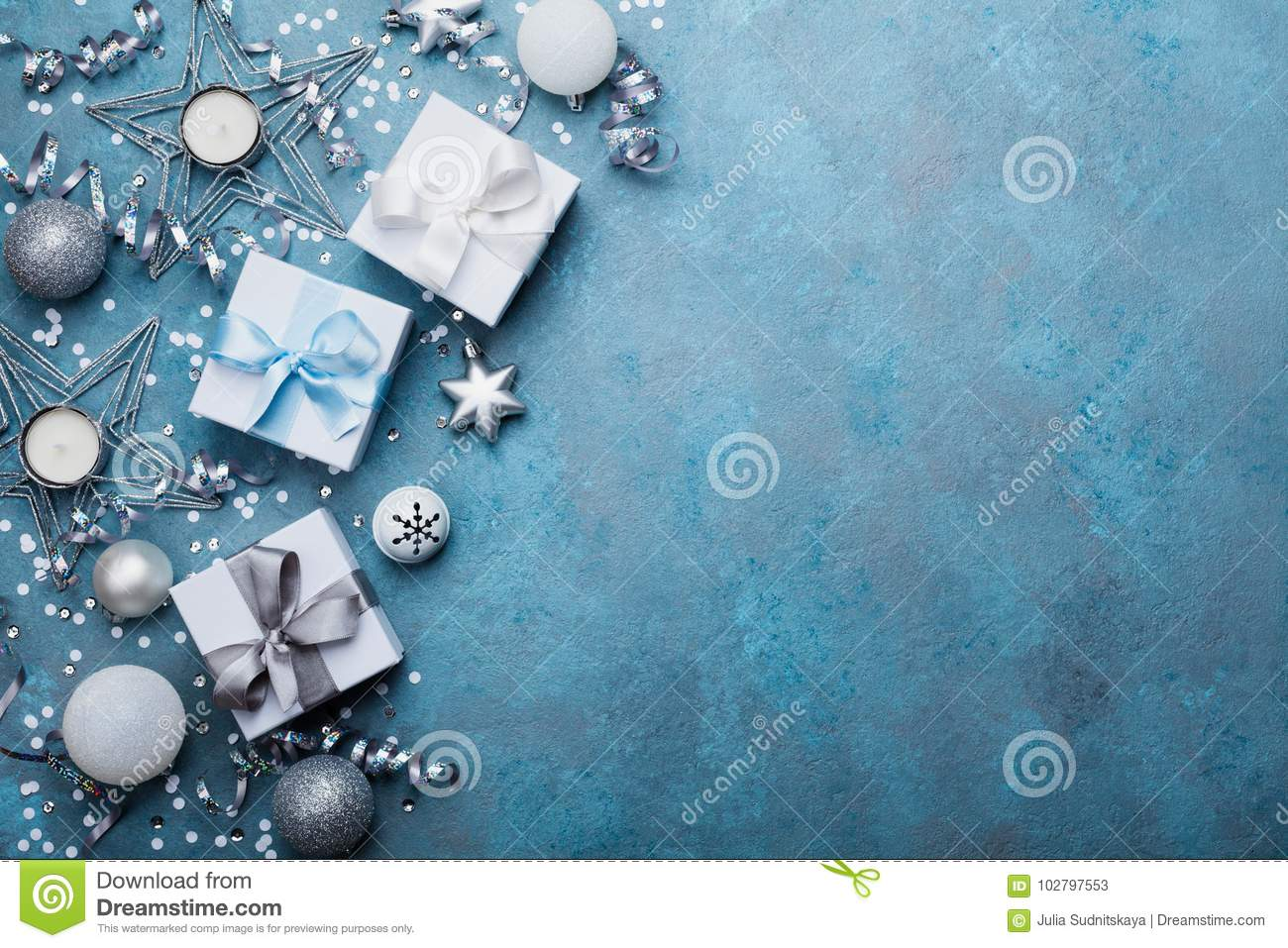 Holiday background with christmas decoration and gift boxes top view. Festive greeting card. Flat lay style.