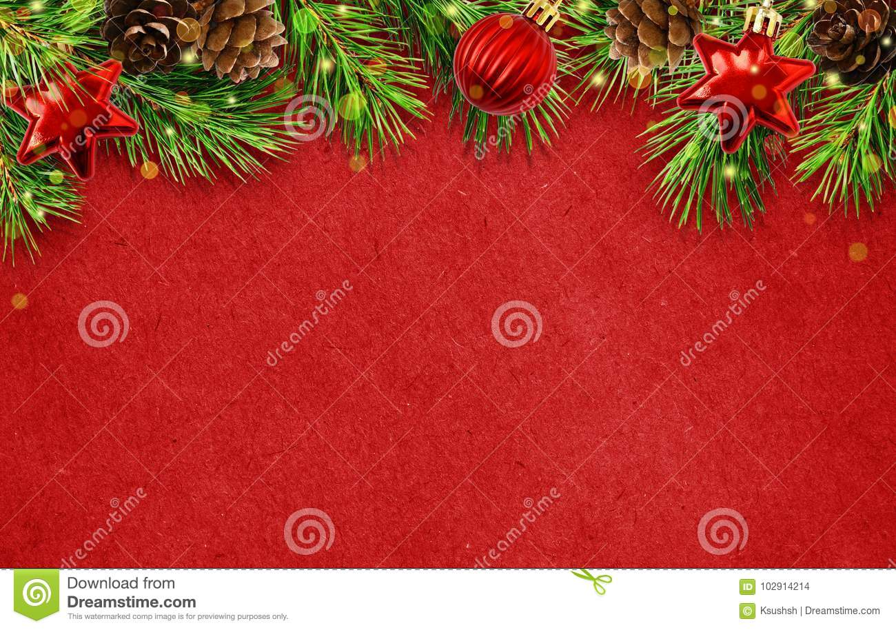 Holiday background with Christmas tree twigs, cones, balls abd l