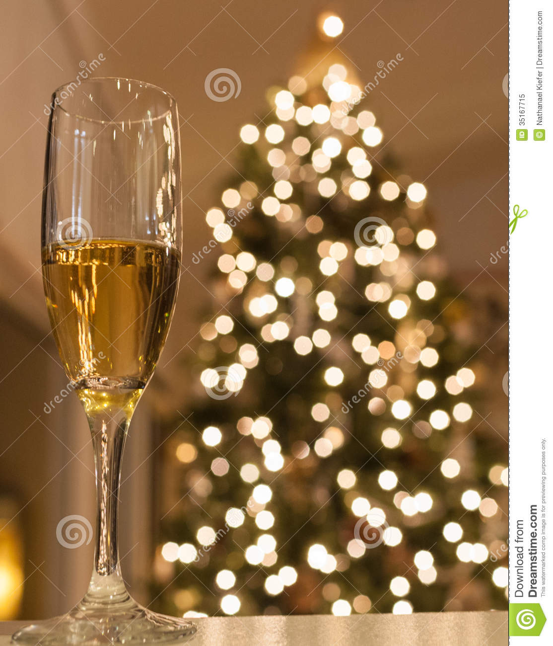 Glass Of Champagne With Christmas Tree Stock Image