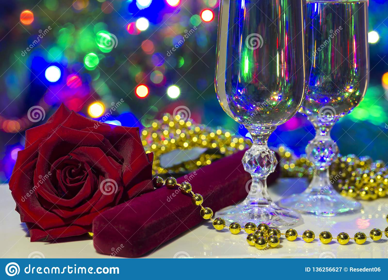 holiday congratulatory photo with cristal glasses and lights