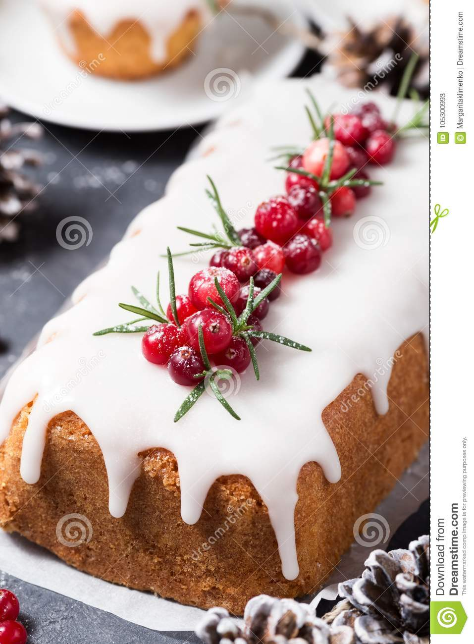 Cranberry Christmas Cake.Christmas Cake With Sugar Icing Cranberries And Rosemary
