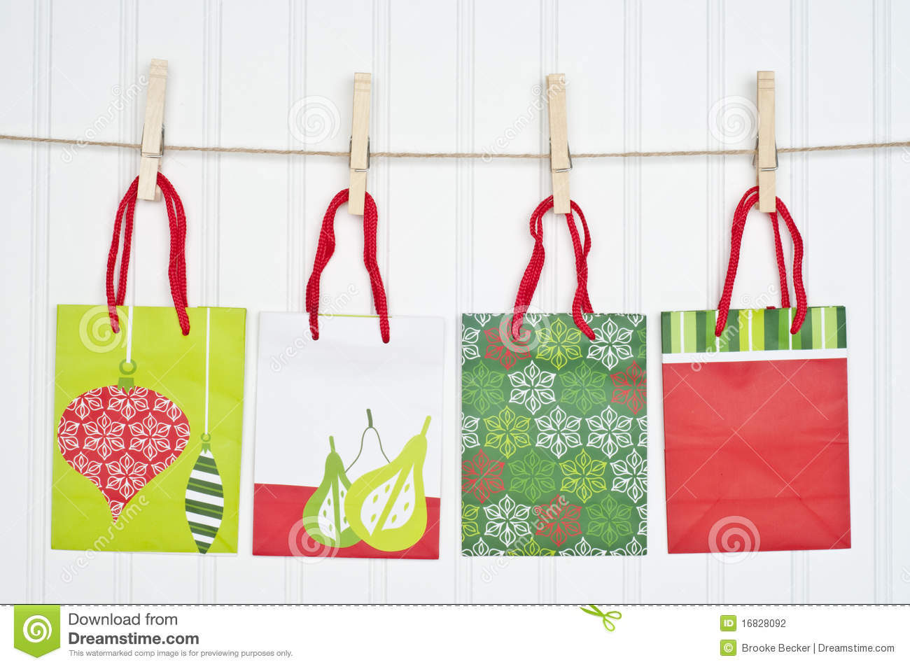 Holiday Gift Bags on a Clothesline  sc 1 st  Dreamstime.com & Holiday Gift Bags On A Clothesline Stock Photo - Image of finance ...