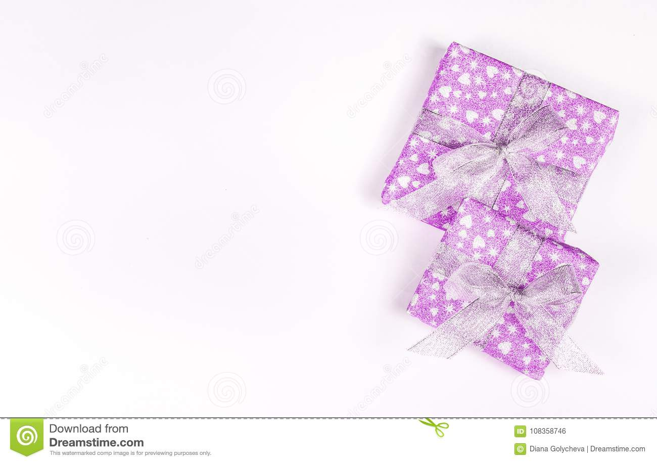 Holiday gift boxes with bows and hearts. St. Valentine`s Day. Brilliant boxes.