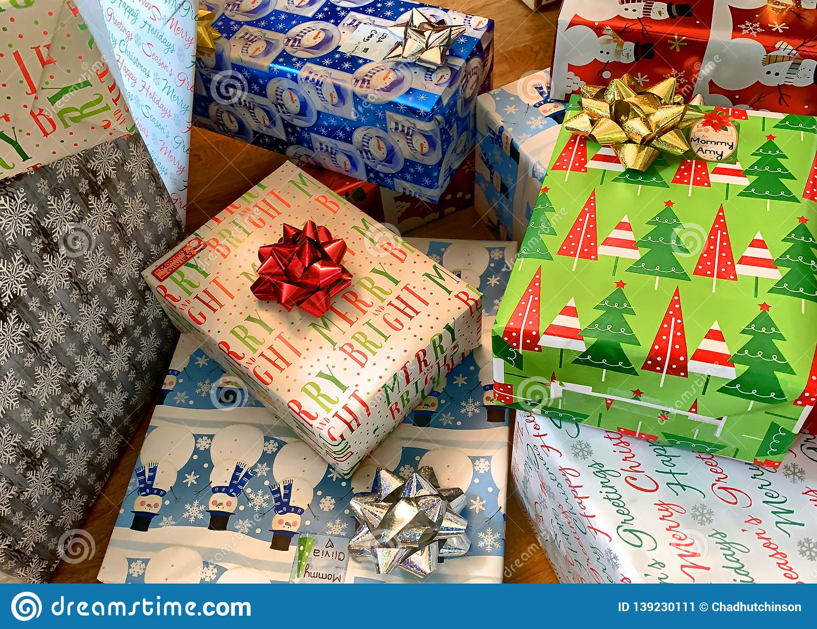 Many Gift Boxes Wrapped In Christmas Themed Gift Wrap Stock