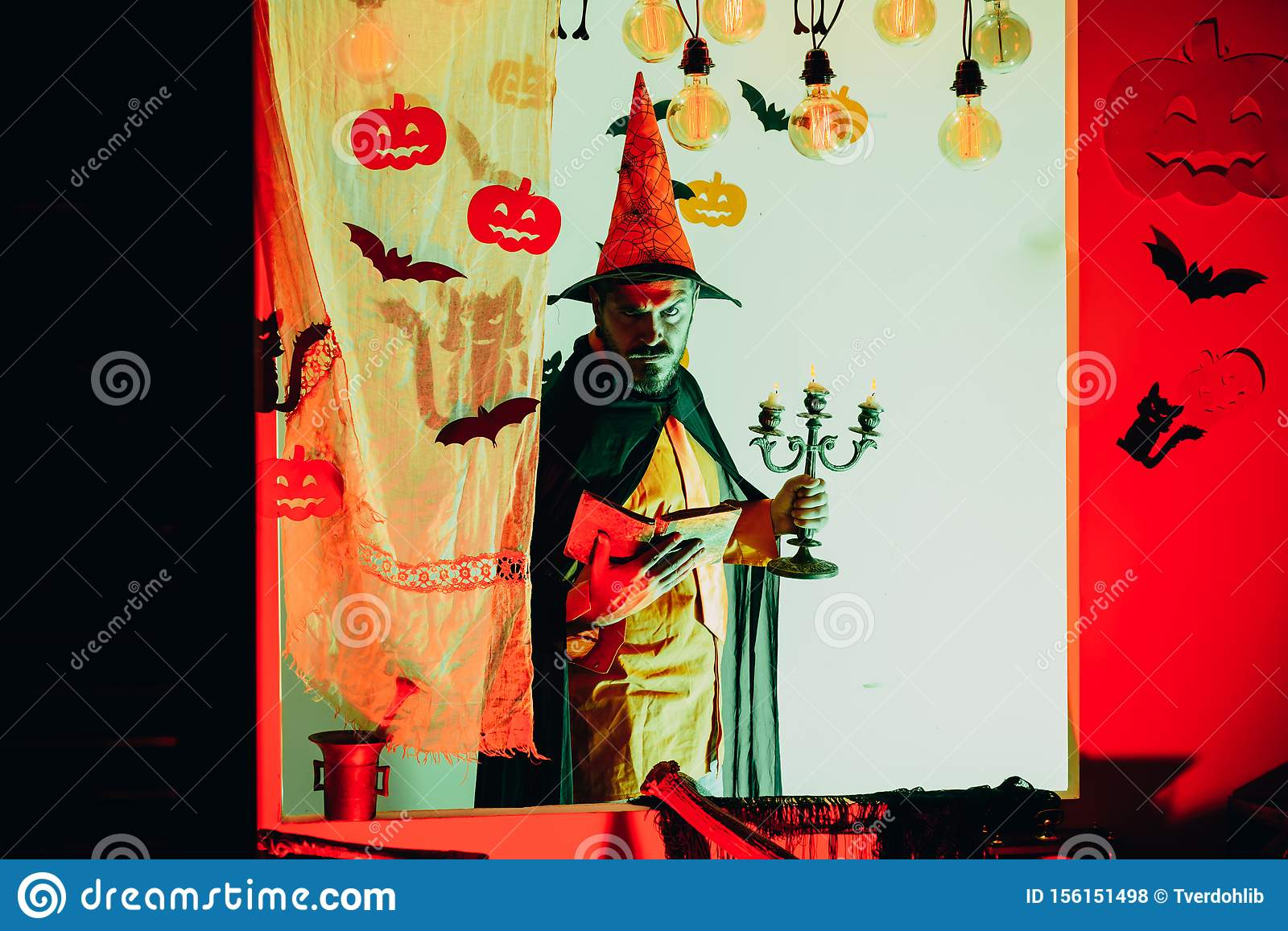 31 october. Make up and scary concept for man. Halloween, holidays celebration. Happy hipster with bloody beard with
