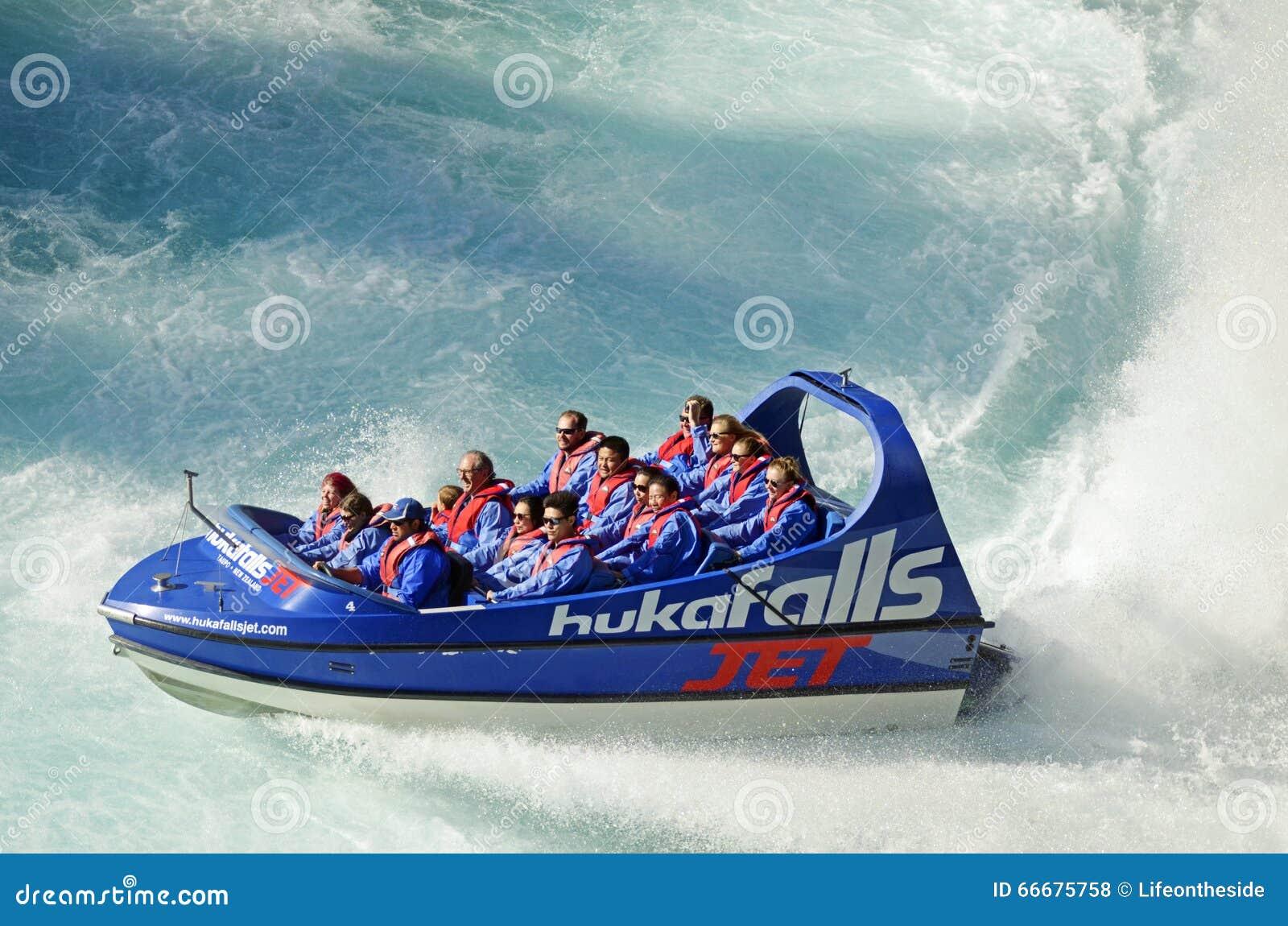 Holiday makers people enjoying thrill of jet boat ride Huka Falls, Lake Taupo, New Zealand